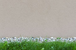 Wall background with rocks and grass Royalty Free Stock Photos