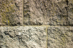Wall background. Stone wall close up background with moss Stock Photography