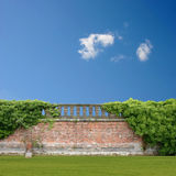 Wall with Balustrade. An Overgrown Wall with Balustrade and Blue Sky Royalty Free Stock Image