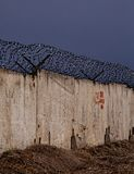 Wall with barbed wire Royalty Free Stock Photo