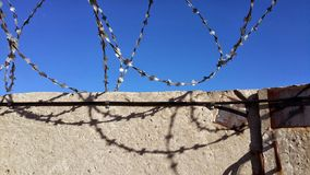Wall with barbed wire Stock Photos