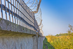 Wall with barbed wire Stock Images