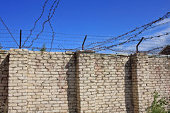 Wall with barbed wire Royalty Free Stock Image