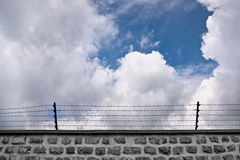 Wall and barbwire Stock Photography