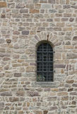 Wall with barred window. Historic stone wall with barred window in Fulda, a city in Hesse, Germany Royalty Free Stock Photo