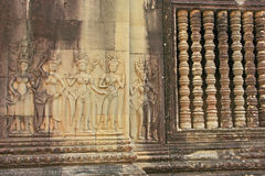 Wall bas-relief of Devatas, Angkor Wat temple Stock Photo