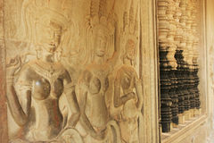 Wall bas-relief of Devatas, Angkor Wat temple, Siem Reap, Cambodia. Southeast Asia Royalty Free Stock Image