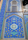 Wall with beautiful design of ceramic tiles in traditional Persian style, Isfahan, Iran. Stock Photos