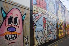 Wall with beautiful graffiti, street art.  Royalty Free Stock Photo