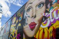 Wall with beautiful graffiti, street art.  Royalty Free Stock Photos
