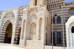 Wall with a beautiful texture of a Muslim Islamic Arab mosque made of white brick architecture with arches, domes and doors and ca stock image
