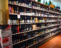 A Wall of Beer in a Supermarket. A huge selection of beer lines supermarket shelves stock images
