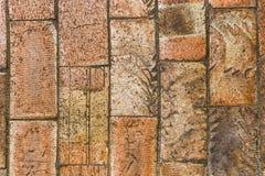 Wall of big brown bricks stock photography