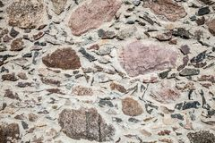 Wall of big stones and broken bricks. Old wall made of big stones and broken bricks. Vintage rough blocks surface background stock photography