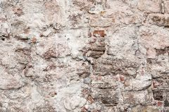Wall of big stones and broken bricks stock photography