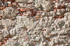 Wall of big stones and broken bricks royalty free stock photos