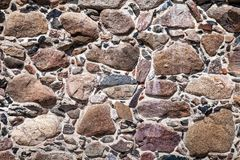 Wall of big stones and broken bricks royalty free stock image