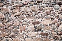 Wall of big stones and broken bricks. Old wall made of big stones and broken bricks. Vintage rough blocks surface background stock photos