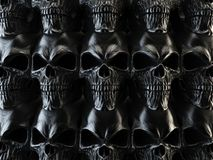 Wall of black metal skulls. Isolated on white background Royalty Free Stock Images