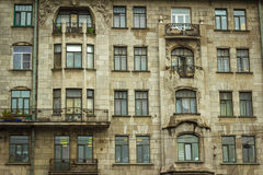 Wall of a block of flats with balconies. The wall of an apartment building, windows with balconies in St. Petersburg Royalty Free Stock Photography