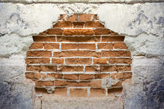 Wall with a blue brick Royalty Free Stock Images
