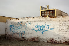 Wall with blue graffiti, realistic Royalty Free Stock Images