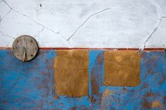 Wall with blue paint. And wooden circle Royalty Free Stock Photos