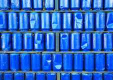Wall of blue painted used metal cans background Royalty Free Stock Photo