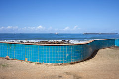 Wall with Blue Tiles by the Ocean Royalty Free Stock Photos