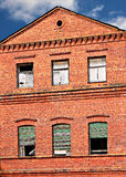 Wall with boarded up windows Stock Photography