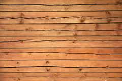 The wall from boards. Fragment of the wall of boards with texture, cracked, brown fiber Royalty Free Stock Image