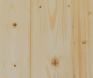 Wall of bonded boards with knots Royalty Free Stock Images
