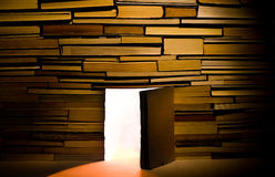 Wall of books with open door Royalty Free Stock Photos