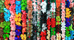 Wall of Bows. Assorted hair bows in many colors and sizes stock images