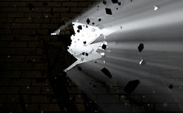 Wall Break Through And Light. A dark side of a wall being broken and shattered with light emanating through Royalty Free Stock Images