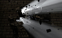 Wall Break Through And Light. A dark side of a wall being broken and shattered by a wrecking ball with light emanating through Royalty Free Stock Images