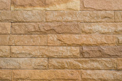 Wall of brick. Background of stone wall made with blocks Stock Photo