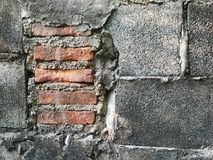 Wall Brick Block.The brick wall is gray, cracking red brick with cement on the inside royalty free stock photography