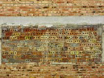 A wall of brick with a different type of masonry. The window opening in the brick wall is laid with bricks using a different type of masonry stock photography