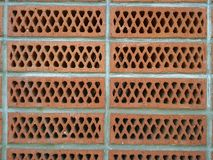 Wall of Brick with holes. Red brick with square holes and cement wall Royalty Free Stock Photos