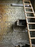 Wall brick with  ladder and wires Royalty Free Stock Photo