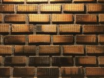 Wall. Brick wall with light from the top Royalty Free Stock Image