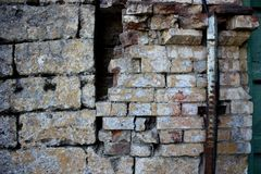 Wall of brick masonry aged. Painted street brushed grunge background texture color stock photo