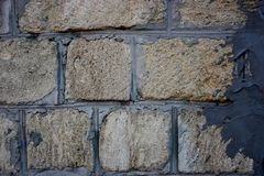 Wall of brick masonry aged. Painted street brushed grunge background texture color royalty free stock photos