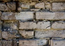Wall of brick masonry aged. Painted street brushed grunge background texture color royalty free stock photography