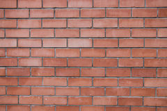 Wall. Brick wall red with cement layer Stock Photo