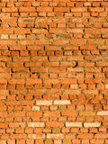 Wall from a brick in a slanting sunlight. Laying of a wall from a red brick Royalty Free Stock Image