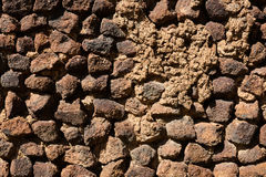 wall of brick, tuff and stone. Royalty Free Stock Photo