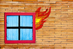 Wall brick with window in  fire Stock Images