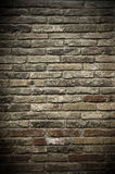 Wall of bricks. A wall of aged grey and red bricks Stock Photo